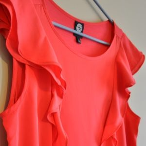 Bright pink top with flowy detail